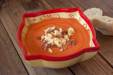 Spanish salmorejo, a cold tomato cream served with boiled egg and serrano ham.